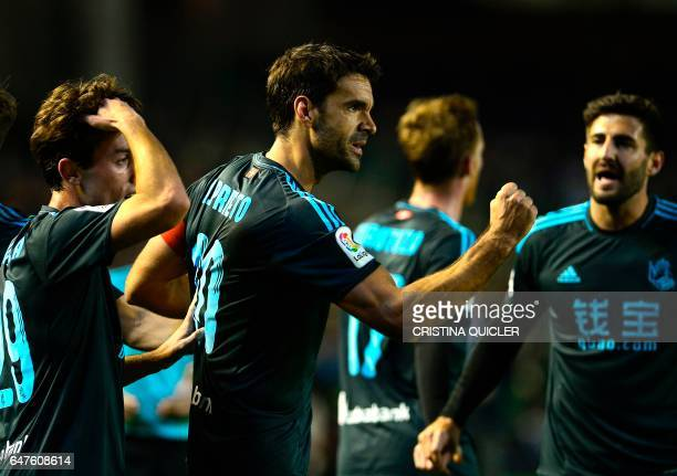 Real Sociedad's forward Real Sociedad's midfielder Xabier Prieto celebrates with teammates after scoring during the Spanish league football match...