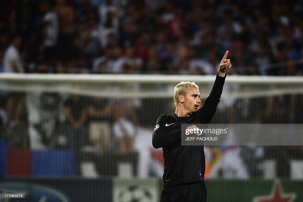 Real Sociedad's French midfielder <a gi-track='captionPersonalityLinkClicked' href=/galleries/search?phrase=Antoine+Griezmann&family=editorial&specificpeople=7197539 ng-click='$event.stopPropagation()'>Antoine Griezmann</a> celebrates after scoring a goal during the first leg of the UEFA Champions League's playoffs football match Olympique Lyonnais vs Real Sociedad on August 20, 2013 at the Gerland stadium in Lyon, eastern France.