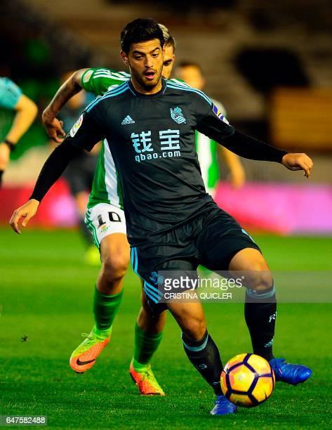 Real Sociedad's Mexican forward Carlos Vela controls the ball during the Spanish league football match Real Betis vs Real Sociedad at the Benito...
