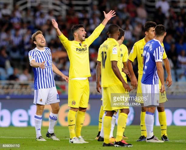 Real Sociedad's midfielder Asier Illarramendi and Villarreal's defender Alvaro Gonzalez gesture during the Spanish league football match Real...