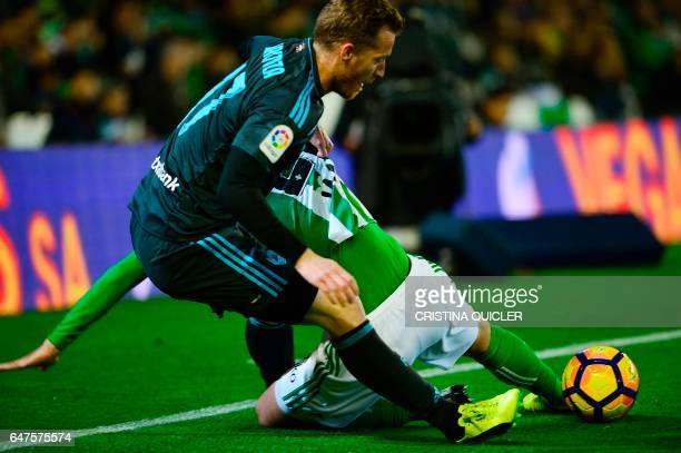 Real Sociedad's midfielder David Zurutuza vies with Betis' Argentinian defender German Pezzela during the Spanish league football match Real Betis vs...