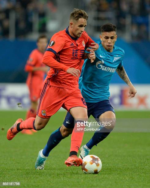 Real Sociedad's midfielder from Belgium Adnan Januzaj and Zenit St Petersburg's midfielder from Argentina Leandro Paredes vie for the ball during the...