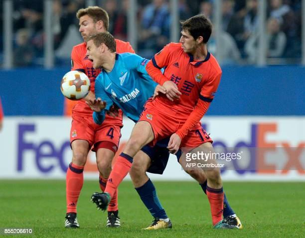 Real Sociedad's midfielder from Spain Asier Illarramendi Zenit St Petersburg's forward from Russia Alexander Kokorin and Real Sociedad's defender...