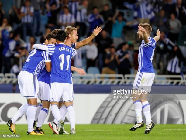 Real Sociedad's midfielder from Spain David Zurutuza celebrates a goal with teammates during the Europa League football match Real Sociedad vs...