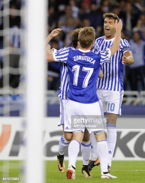 Real Sociedad's midfielder from Spain David Zurutuza celebrates his team's second goal during the Europa League football match Real Sociedad vs...