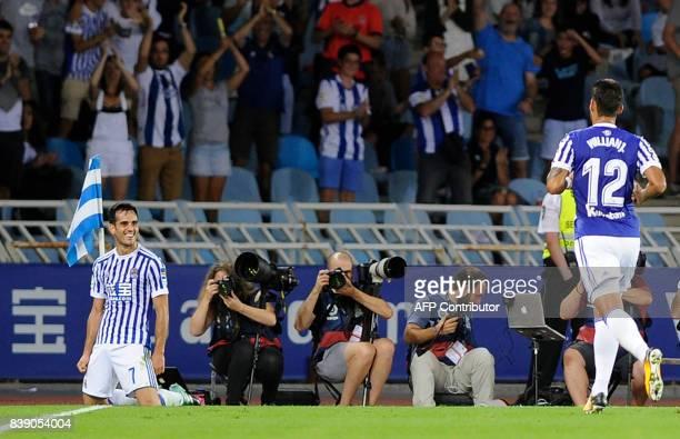 Real Sociedad's midfielder Juanmi celebrates after scoring their third goal during the Spanish league football match Real Sociedad vs Villarreal CF...