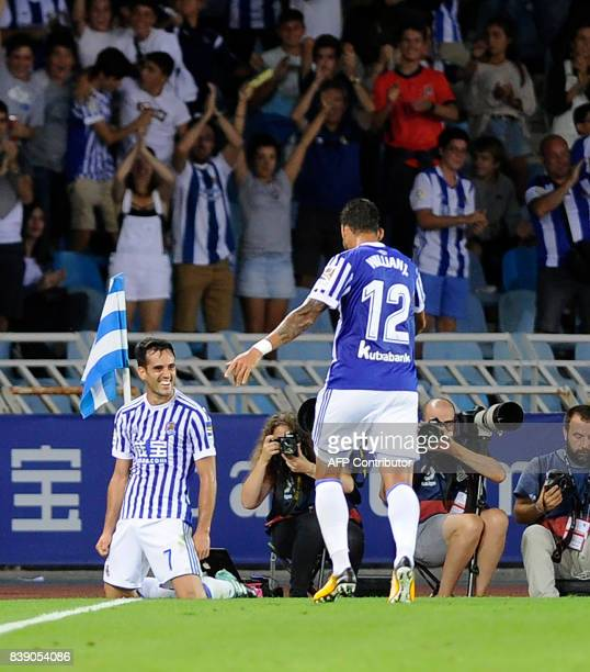 Real Sociedad's midfielder Juanmi celebrates after scoring their third goal during the Spanish league football match Real Sociedad vs Villarreal CF...