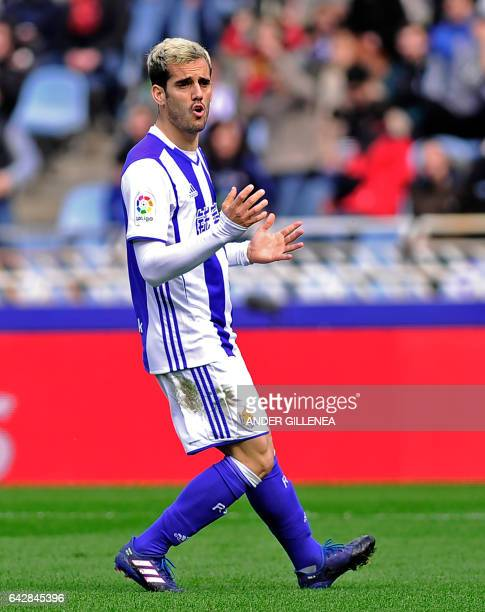 Real Sociedad's midfielder Juanmi gestures as he walks on the pitchduring the Spanish league football match Real Sociedad vs Villarreal CF at the...