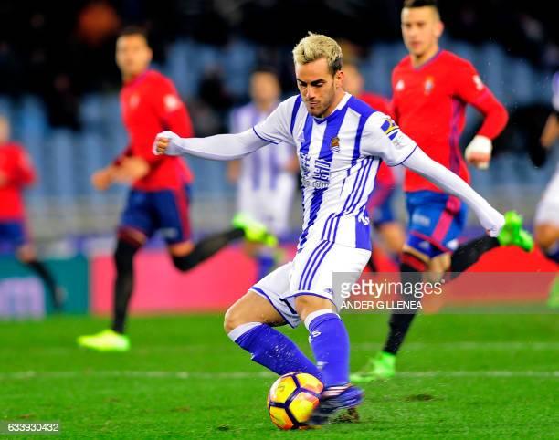 Real Sociedad's midfielder Juanmi kicks to score during the Spanish league football match Real Sociedad vs CA Osasuna at the Anoeta stadium in San...
