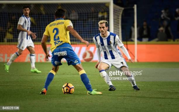 Real Sociedad's midfielder Juanmi vies Las Palmas' defender David Simon during the Spanish league football match UD Las Palmas vs Real Sociedad at...