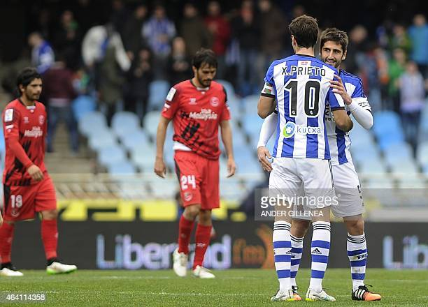 Real Sociedad's midfielder Xabi Prieto and midfielder Markel Bergara celebrate after winning the Spanish league football match Real Sociedad de...