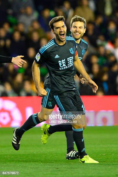 Real Sociedad's midfielder Xabier Prieto celebrates with a teammate after scoring during the Spanish league football match Real Betis vs Real...