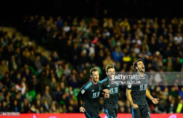 Real Sociedad's midfielder Xabier Prieto celebrates with teammates after scoring during the Spanish league football match Real Betis vs Real Sociedad...