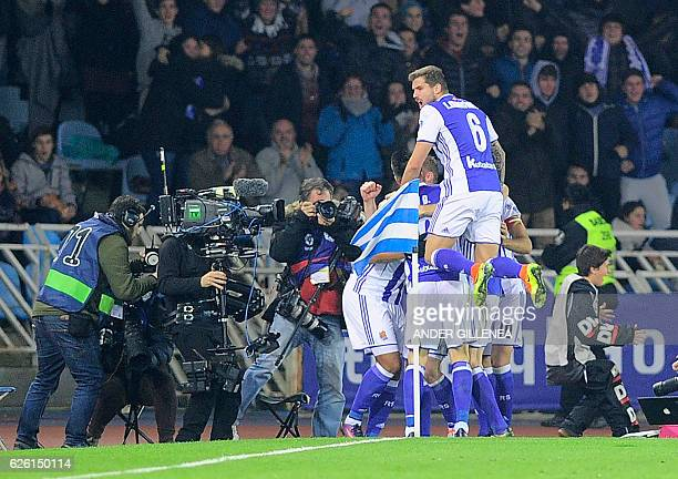 Real Sociedad's players celebrate after Brazilian forward Willian Jose scored a goal during the Spanish league football match Real Sociedad vs FC...