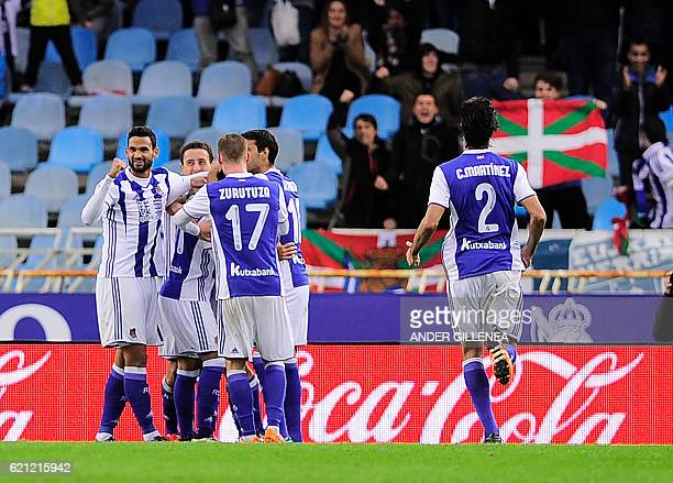 Real Sociedad's players celebrate after Mexican forward Carlos Vela scoring his team's first goal during the Spanish league football match Real...