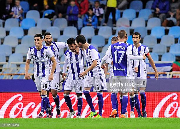 Real Sociedad's players celebrate after Mexican forward Carlos Vela scored his team's first goal during the Spanish league football match Real...