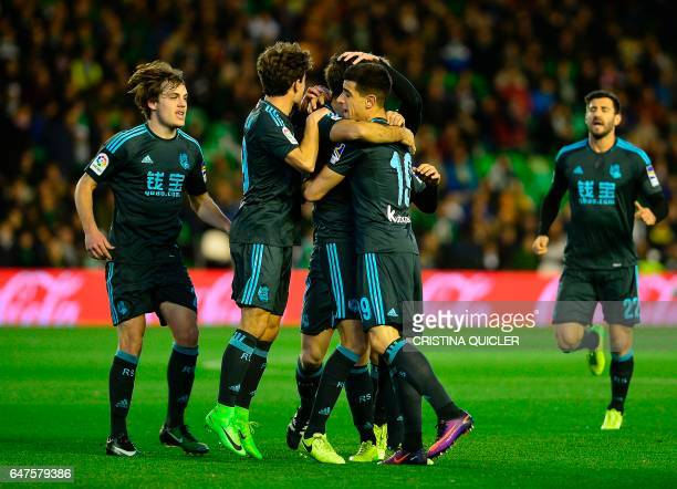 Real Sociedad's players celebrate after Real Sociedad's midfielder Xabier Prieto scored during the Spanish league football match Real Betis vs Real...