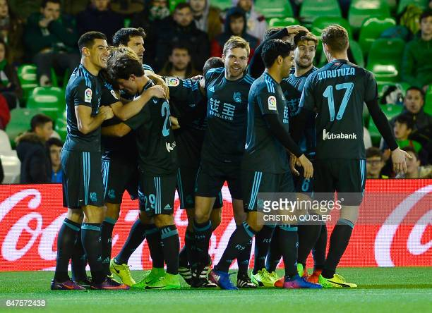 Real Sociedad's players celebrate after scoring the opener during the Spanish league football match Real Betis vs Real Sociedad at the Benito...