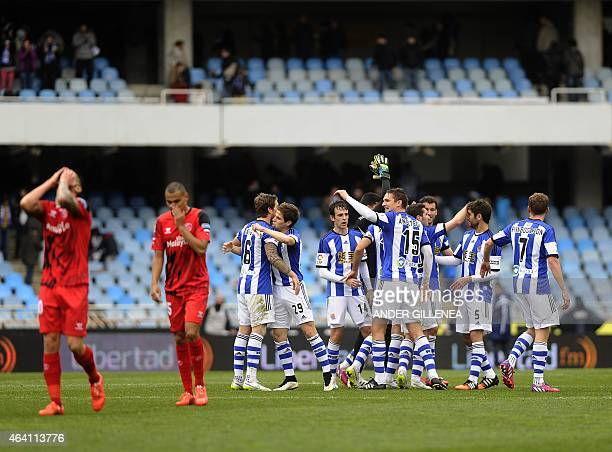 Real Sociedad's players celebrate after winning the Spanish league football match Real Sociedad de Futbol vs Sevilla FC at the Anoeta stadium in San...