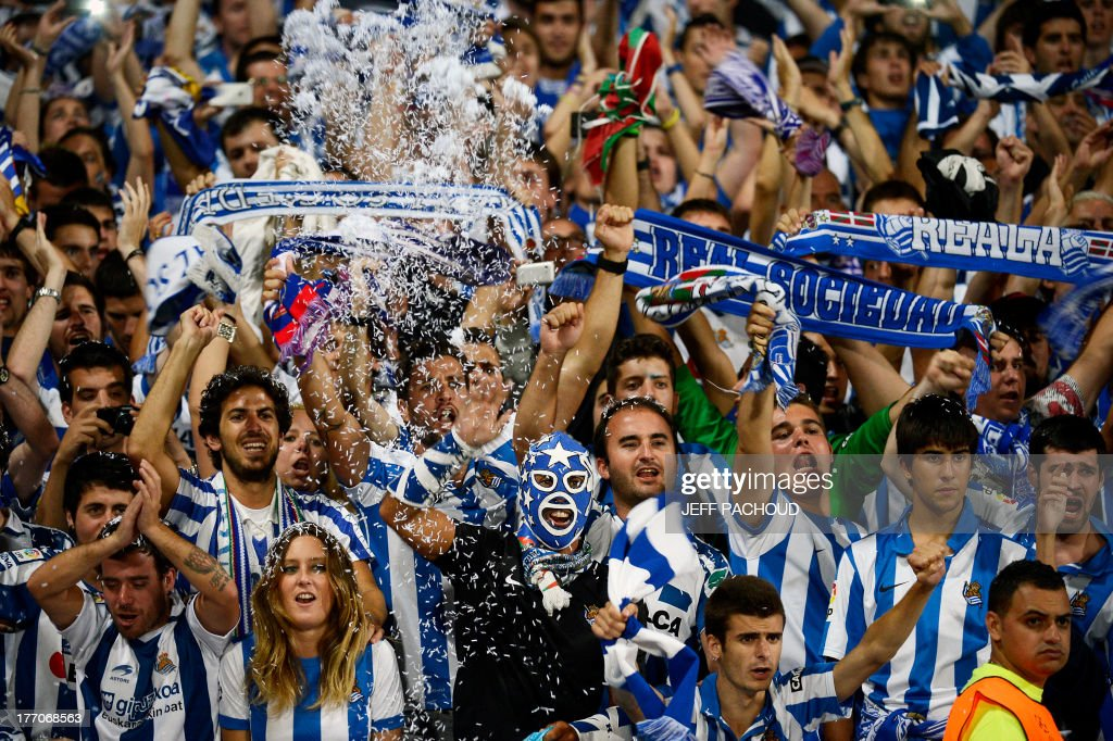 Real Sociedad's supporters celebrate as their team wins the first leg of the UEFA Champions League's playoffs football match Olympique Lyonnais vs Real Sociedad on August 20, 2013 at the Gerland stadium in Lyon, eastern France. AFP PHOTO / JEFF PACHOUD