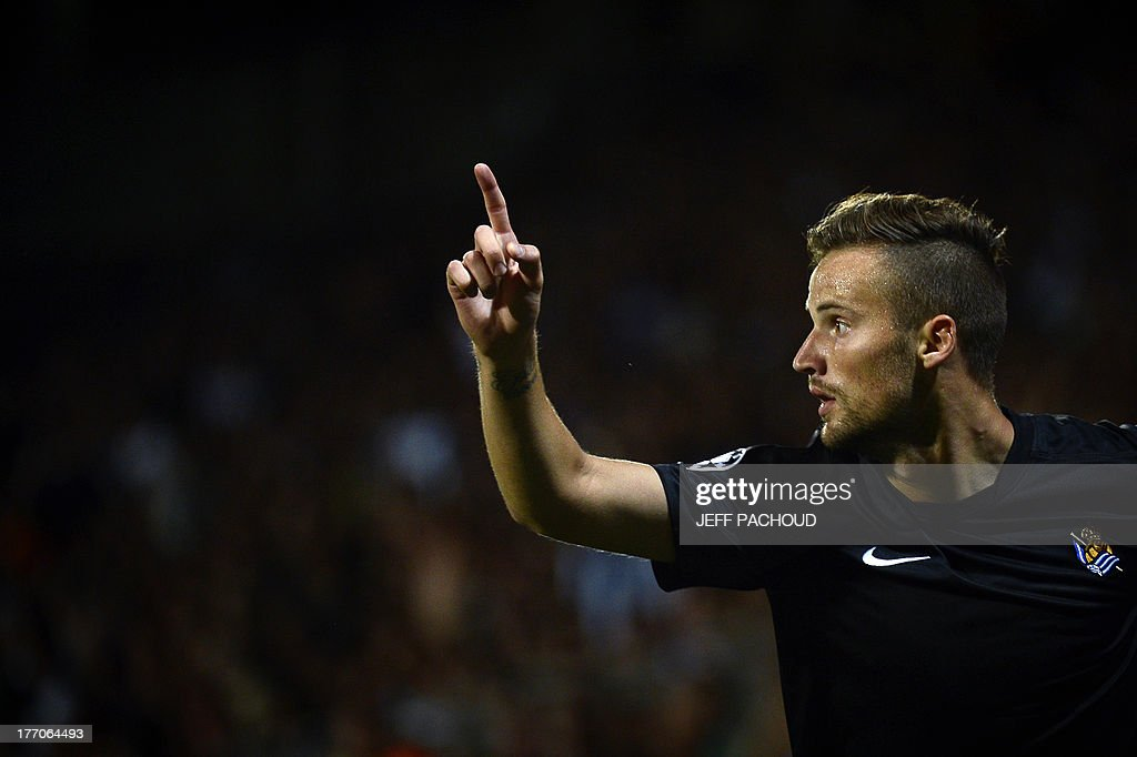 Real Sociedad's Swiss forward Haris Seferovic celebrates after scoring a goal during the first leg of the UEFA Champions League's playoffs football match Olympique Lyonnais vs Real Sociedad on August 20, 2013 at the Gerland stadium in Lyon, eastern France. AFP PHOTO / JEFF PACHOUD