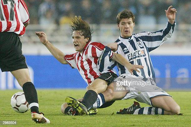 Real Sociedad's Xabi Alonso vies with Athletic Bilbao's Carlos Gurpegui 14 February 2004 during a Spanish Liga match in San Sebastian AFP PHOTO /...