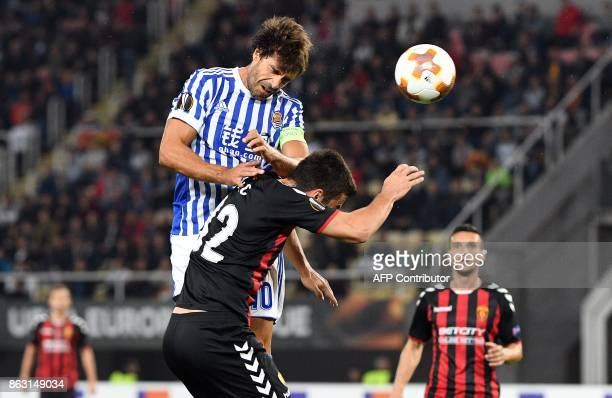 Real Sociedad's Xabi Prieto vies with Vardar's Darko Glisic during the UEFA Europa League Group L football match between FK Vardar and Real Sociedad...