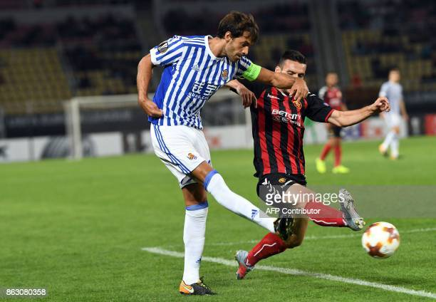 Real Sociedad's Xabi Prieto vies with Vardar's Nikola Gligorov during the UEFA Europa League Group L football match between FK Vardar and Real...