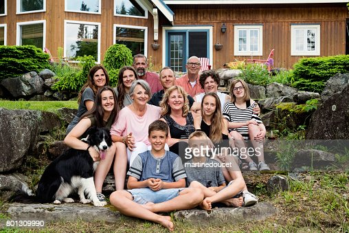 Real three generation family portrait outdoors in summer. : Stock Photo