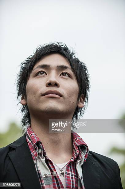 Real Young Asian Guy Portrait looking upwards