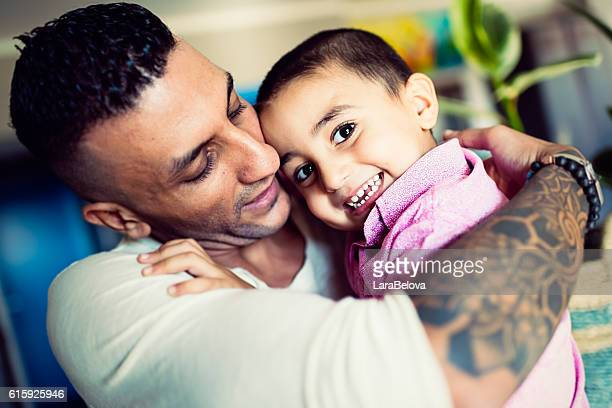 Real young father of Middle East ethnicity with his son