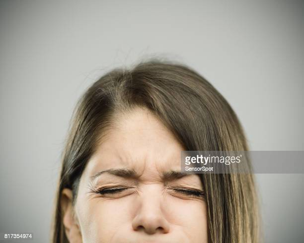 Real young woman with pain expression