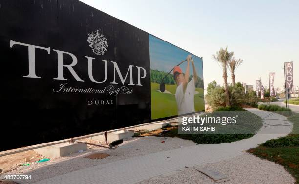 US realestate magnate Donald Trump is seen playing golf on a billboard at the Trump International Golf Club Dubai in the United Arab Emirates on...