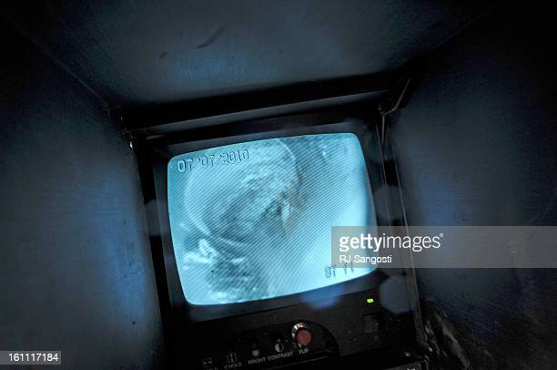 REALESTATE07Jacob Lindhorst Service Technician for Drian Solvers watches a small screen that shows images from a camera on the end of a sewer snake...