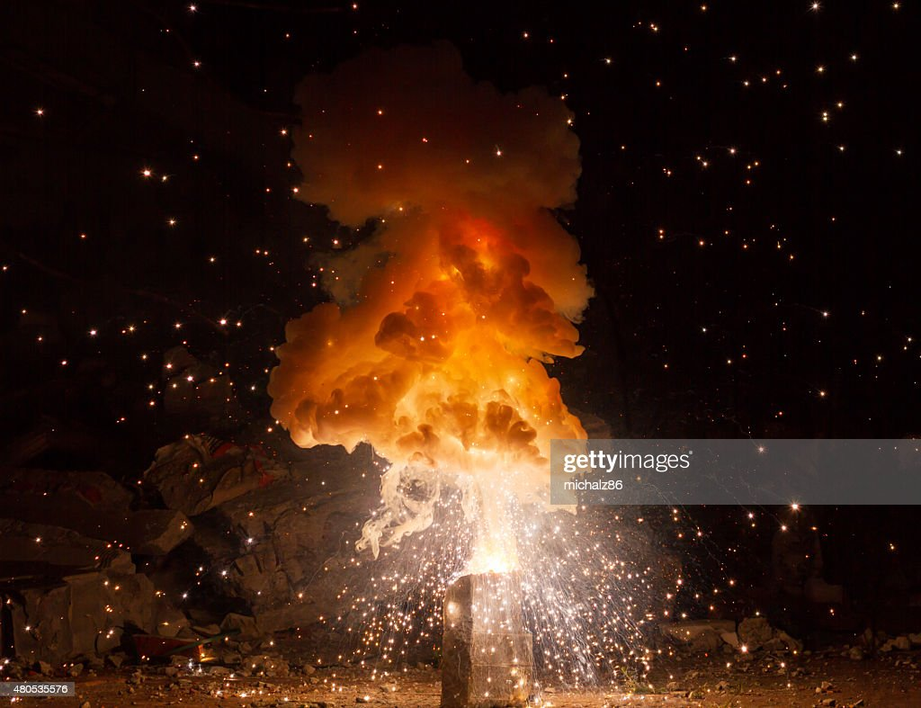 Realistic fiery explosion busting over a black background : Stockfoto