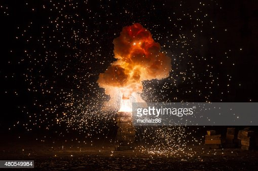 Realistic fiery explosion busting over a black background : Stock Photo