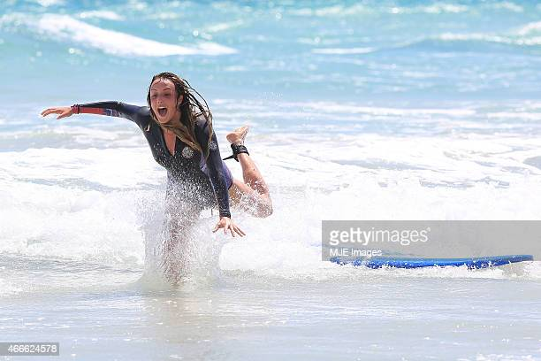 UK reality star Charlotte Crosy takes surfing lessions on March 4 2015 in Perth Australia