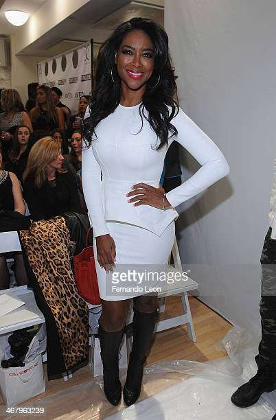 Reality star Kenya Moore attends the Michael Costello fashion show at Helen Mills Event Space on February 8 2014 in New York City