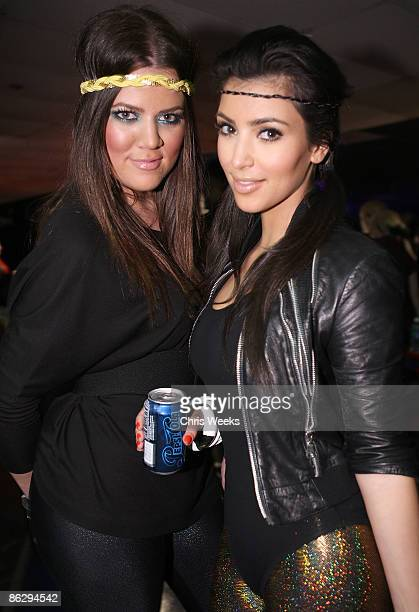 Reality television personalities Khloe Kardashian and Kim Kardashian attends a party launching Pepsi Throwback at World on Wheels on April 29 2008 in...