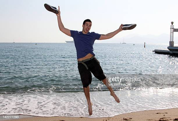US reality television personality Vinny Guadagnino jumps during a photocall for his reality show 'Jersey Shore' at the MIPTV on April 1 2012 in...