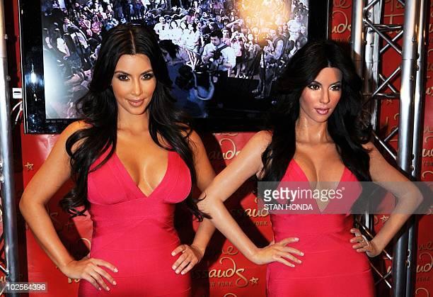 Reality television star Kim Kardashian poses next to her wax figure July 1 2010 at Madame Tussauds New York AFP PHOTO/Stan Honda