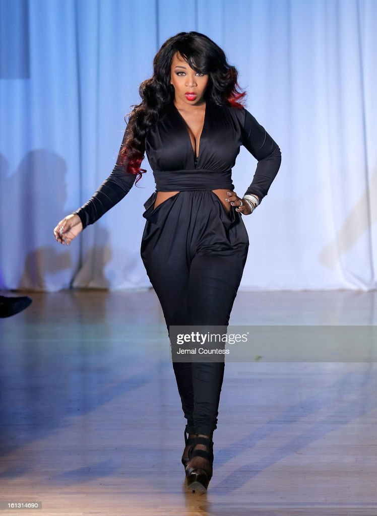 Reality TV actress Tiffany Pollard walks the runway at the Reality of FASHION the Reality of AIDS fall 2013 fashion show during Mercedes-Benz Fashion Week at the Altman Building on February 9, 2013 in New York City.