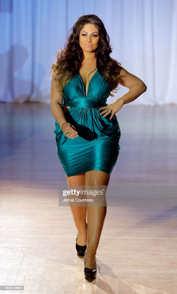 Reality TV actress <a gi-track='captionPersonalityLinkClicked' href=/galleries/search?phrase=Tracy+DiMarco&family=editorial&specificpeople=6851521 ng-click='$event.stopPropagation()'>Tracy DiMarco</a> walks the runway at the Reality of FASHION the Reality of AIDS fall 2013 fashion show during Mercedes-Benz Fashion Week at the Altman Building on February 9, 2013 in New York City.