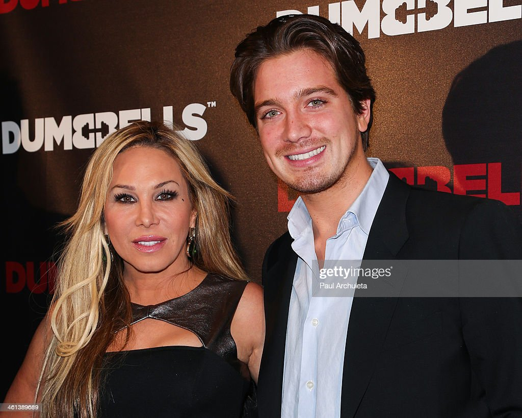 Reality TV Persoanlity Adrienne Maloof (L) and her Boyfriend Jacob Busch (R) attend the 'Dumbells' premiere at SupperClub Los Angeles on January 7, 2014 in Los Angeles, California.