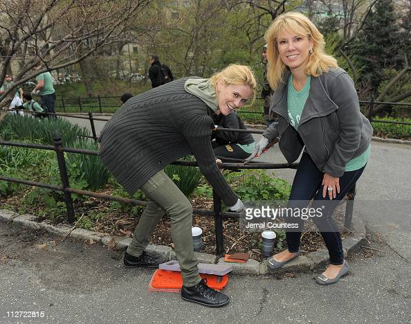 Reality TV personalities Alex McCord and Ramona Singer scrape paint during NBCUniversal's Central Park Beautification project on April 20 2011 in New...