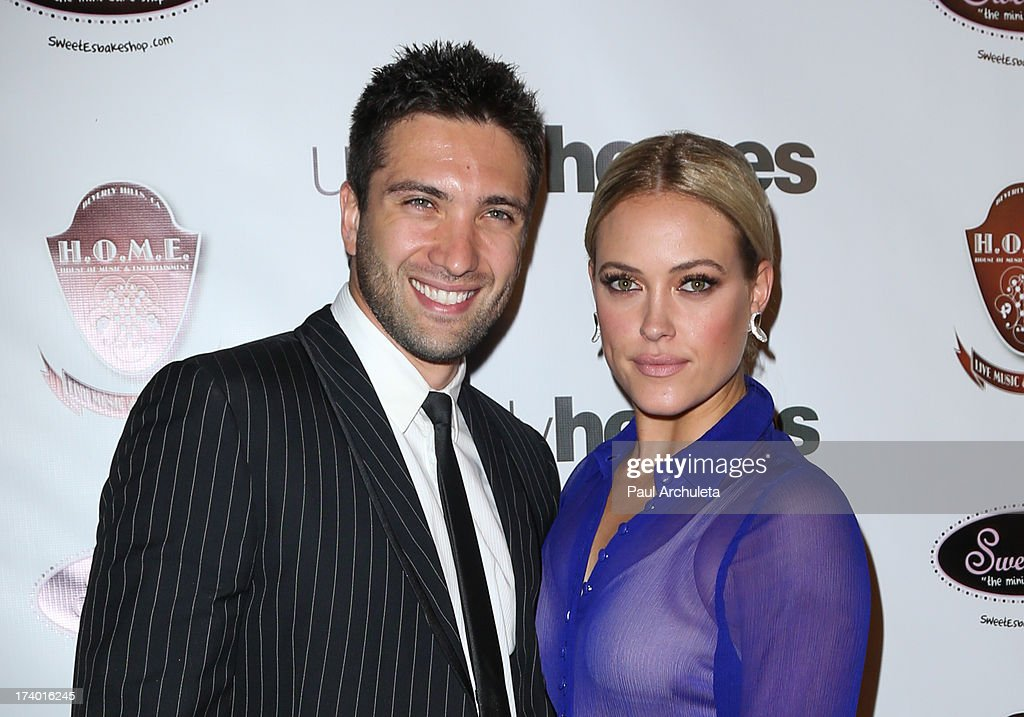 Reality TV Personalities Dmitry Chaplin (L) and Peta Murgatroyd (R) attend the birthday celebration for Chelsie Hightower and Peta Murgatroyd and also supporting the 'Unlikely Heroes' charity organization on July 18, 2013 in Los Angeles, California.