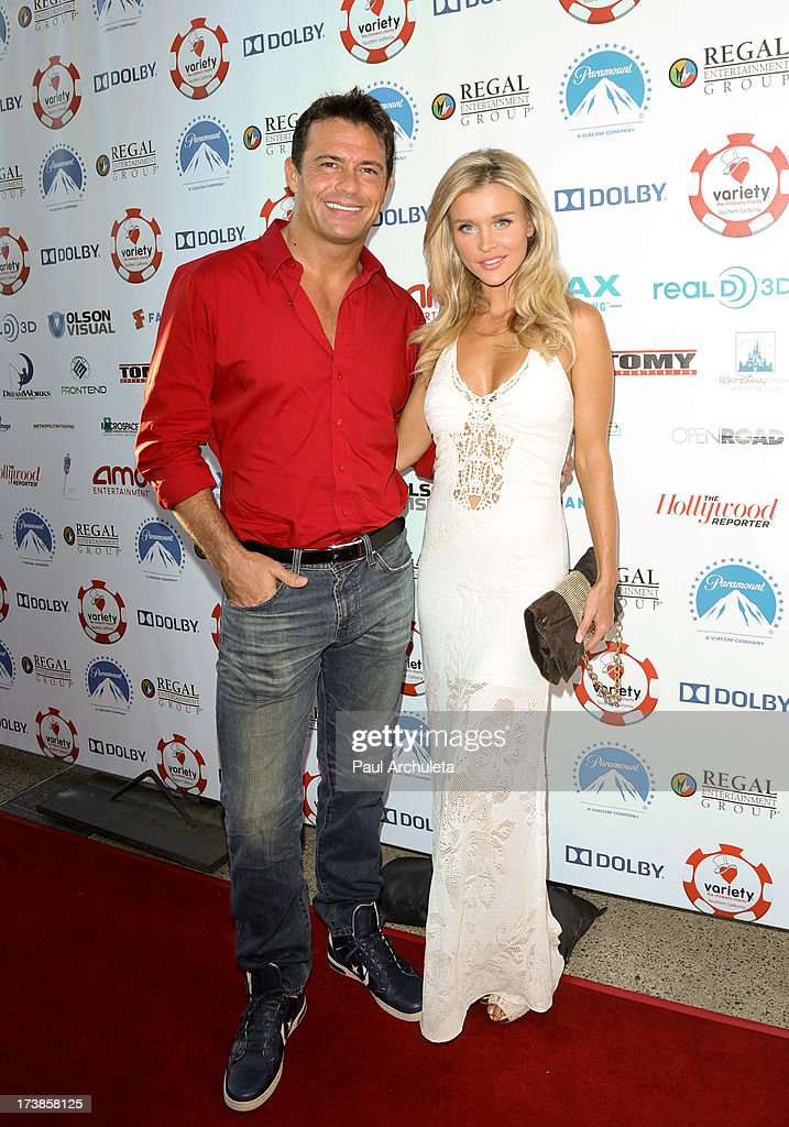 Reality TV Personalities Joanna Krupa (R) and her Husband Romain Zago (L) attend the 3rd annual Variety Charity Texas Hold 'Em Tournament & Casino Game at Paramount Studios on July 17, 2013 in Hollywood, California.