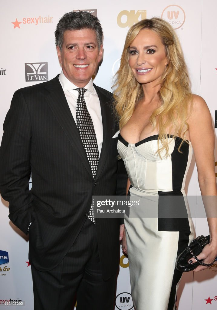 Reality TV Personalities John Bluher (L) and Taylor Armstrong (R) attend OK! Magazine's Pre-Oscar party at The Emerson Theatre on February 22, 2013 in Hollywood, California.