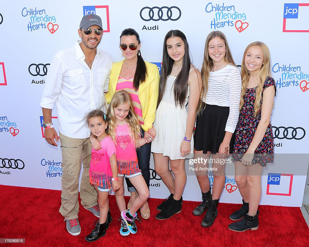 Reality TV Personalities Kyle Richards (R) and Mauricio Umansky (L) attend with their family the 1st annual Children Mending Hearts Style Sunday on June 9, 2013 in Beverly Hills, California.