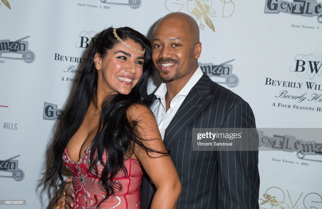 Reality tv personality Asa Soltan Rahmati (L) and Jermaine Jackson Jr. attend Jason Of Beverly Hills' Pre-GRAMMY cocktail hour and salute to fashion icon David Thomas' Gentleman Collection at The Blvd on January 25, 2014 in Los Angeles, California.